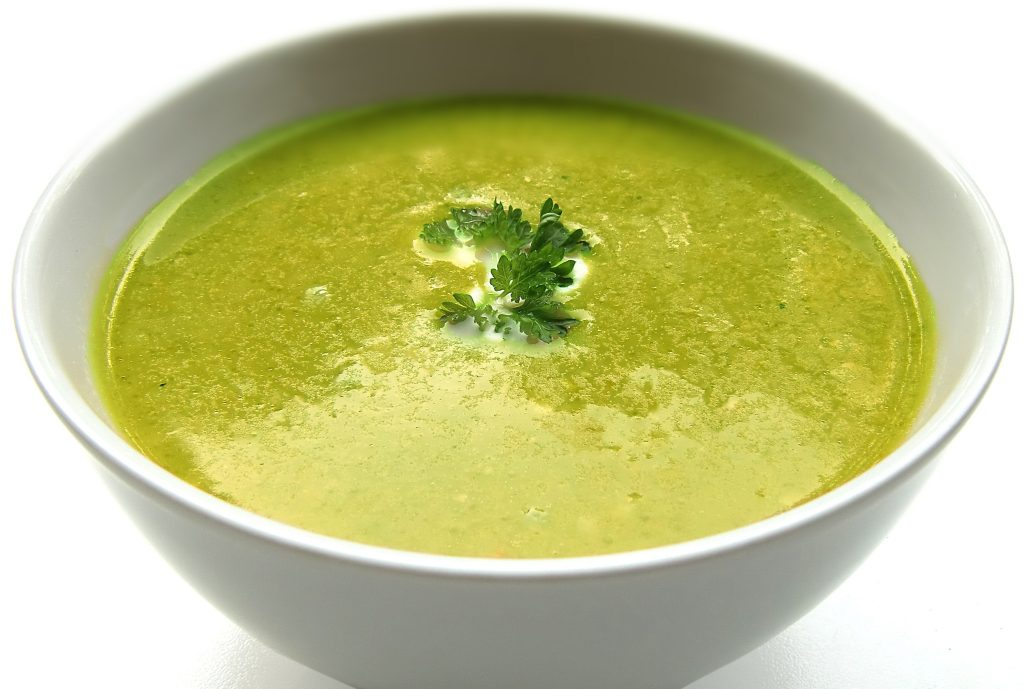 picture of a bowl of zucchini and broccoli soup